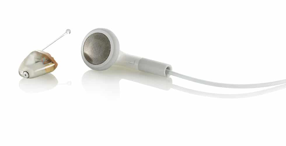 Boutique Audiology Auckland - hearing aid size compared to micro earbud